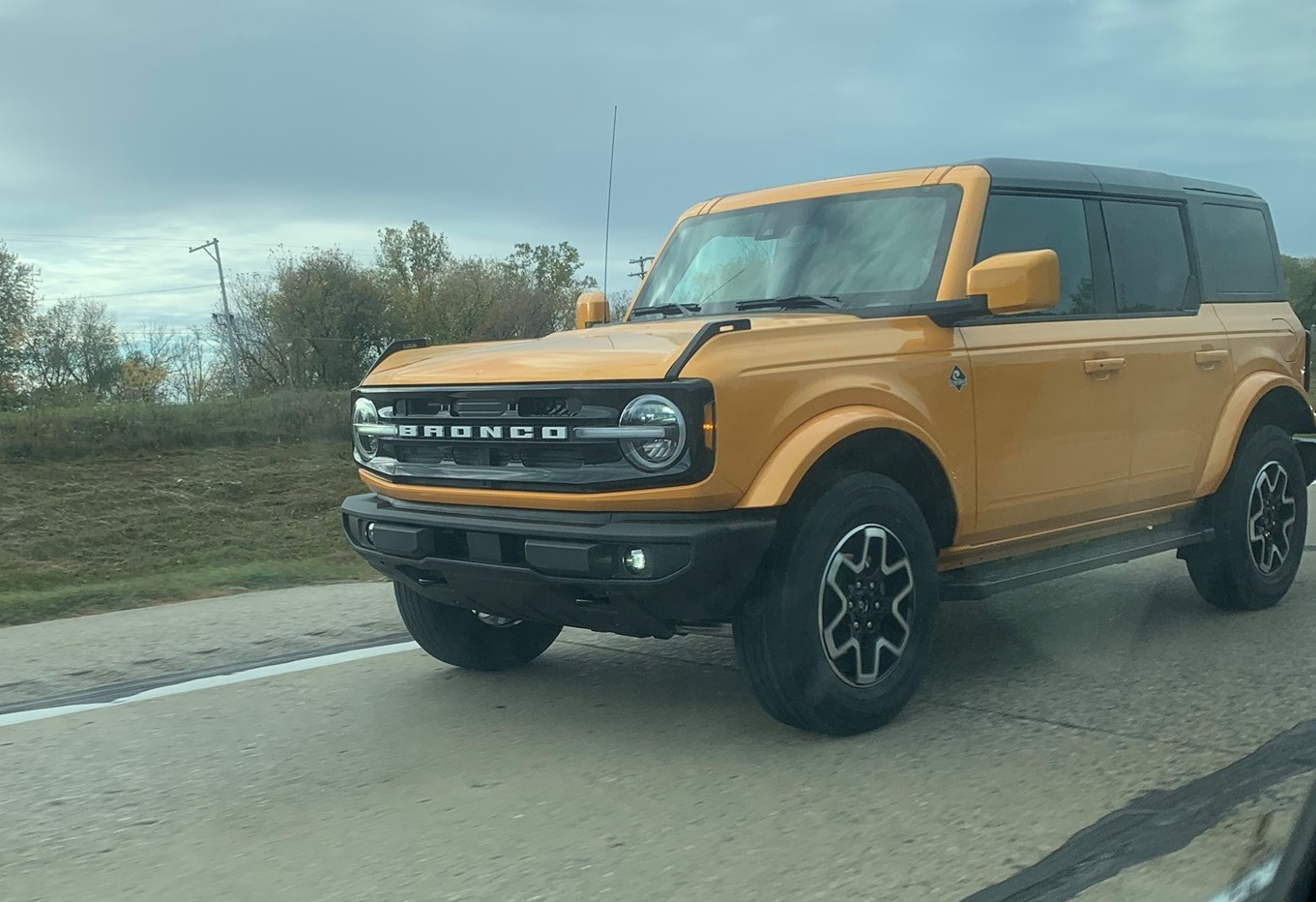 Cyber Orange Outer Banks 2021 Bronco on the road in real life 2.jpg