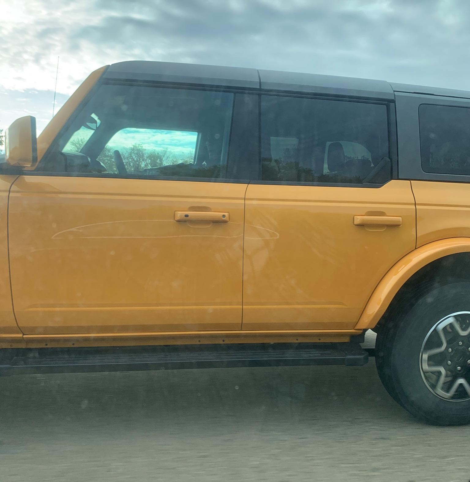 Cyber Orange Outer Banks 2021 Bronco on the road in real life 3.jpg
