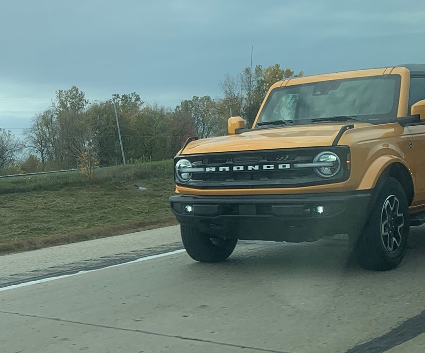 Cyber Orange Outer Banks 2021 Bronco on the road in real life.jpg